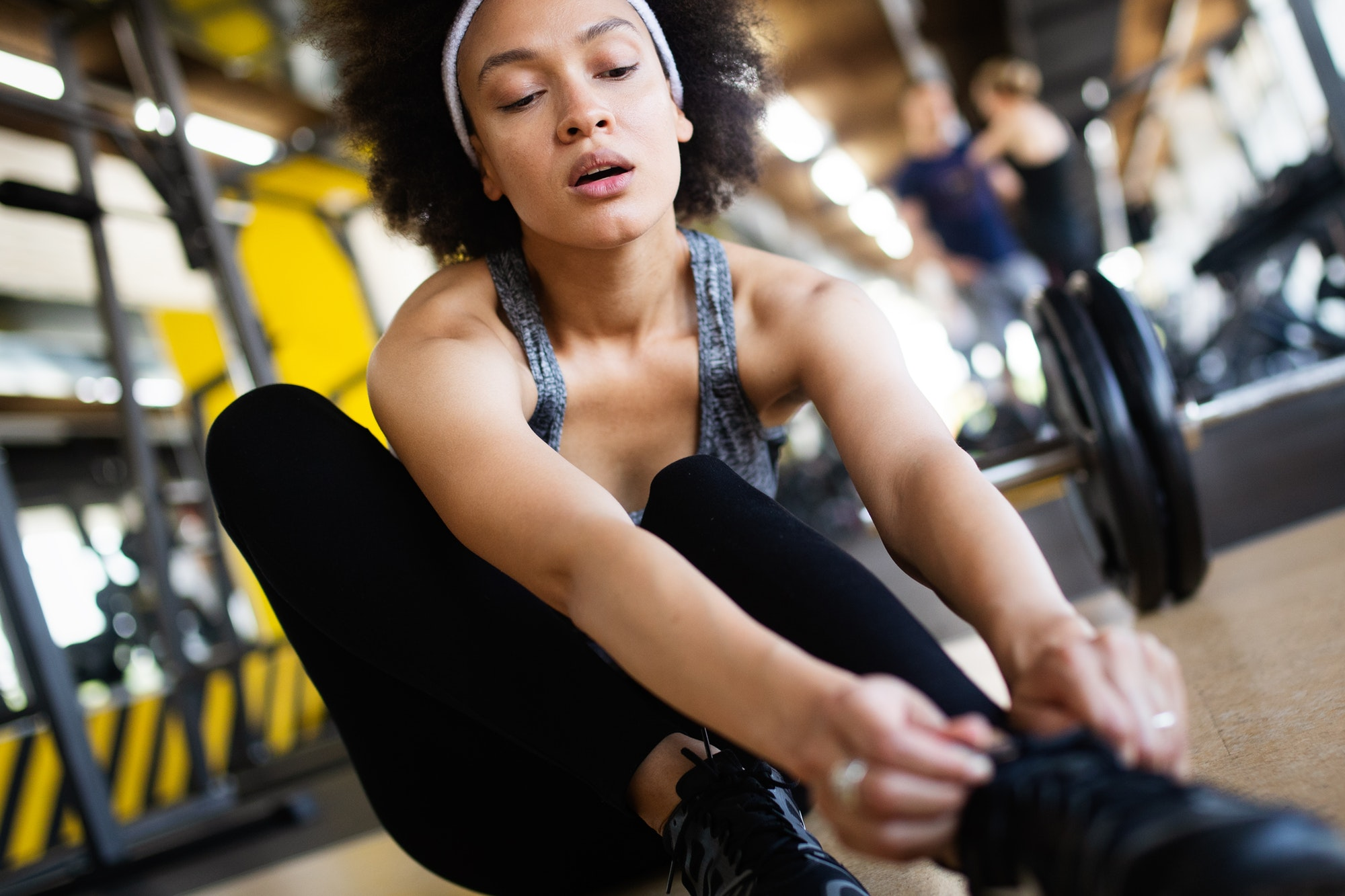 Happy fit african american fitness woman in gym club